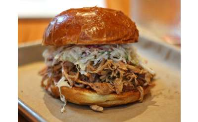 pulled pork sandwich with condiments