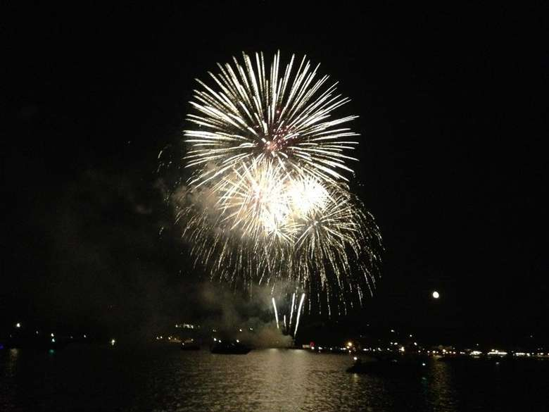large fireworks display over Lake George at night