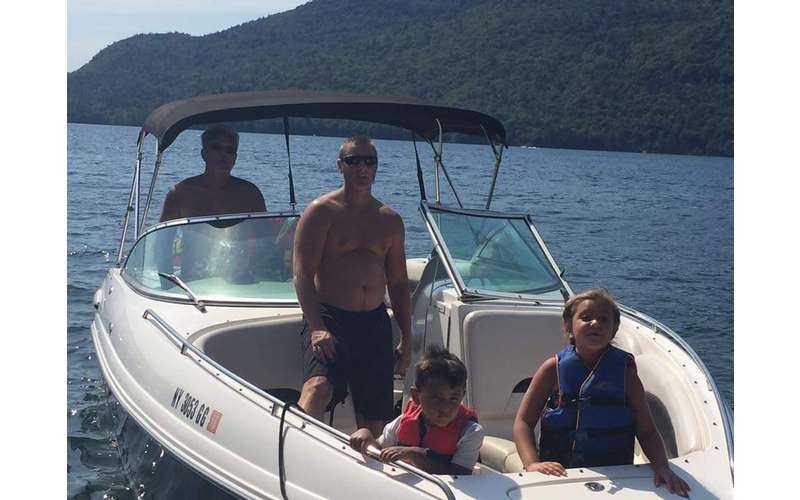 two adults and two kids on board the Chapparal Bowrider motorboat