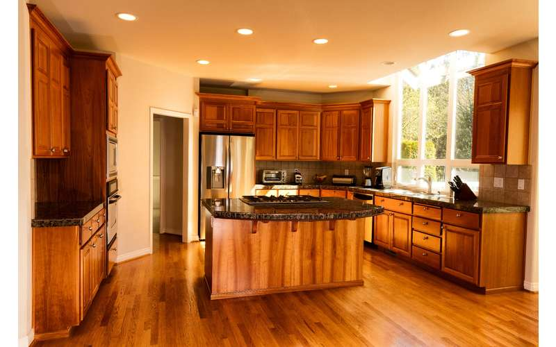a clean kitchen with wooden furnishings