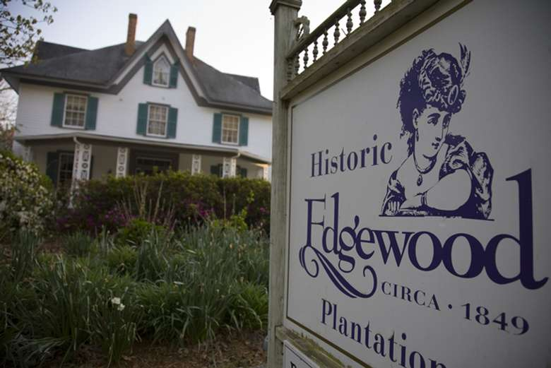 historic edgewood plantation sign in front of the mansion