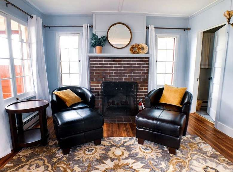 two leather chairs with stools