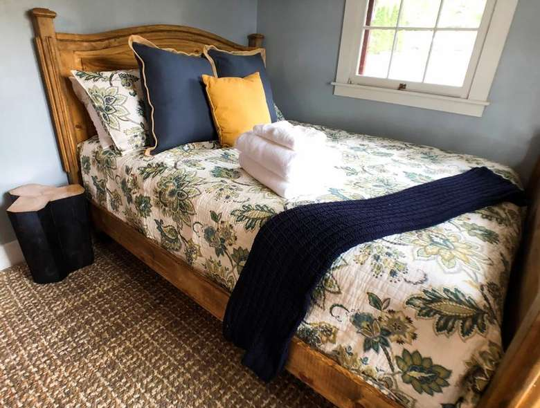 a bed with pillows and blankets