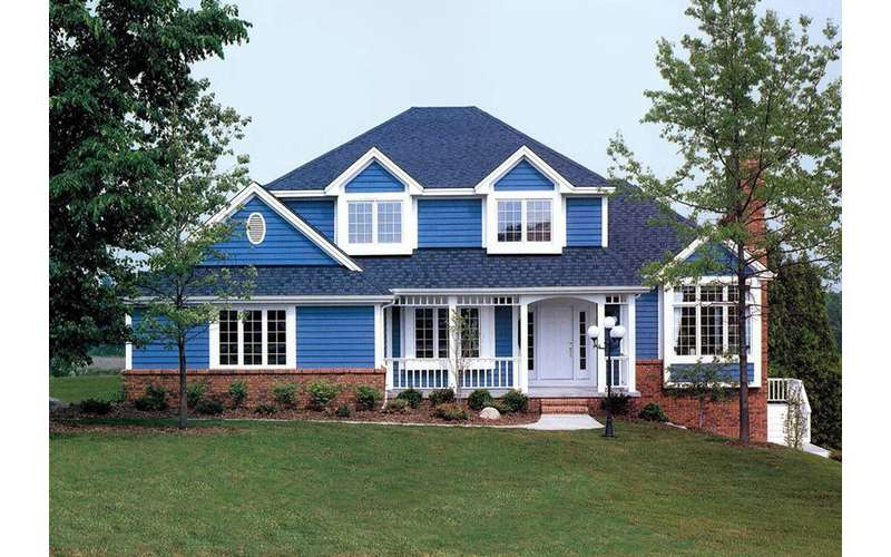 a two story blue house with white around the windows and doors