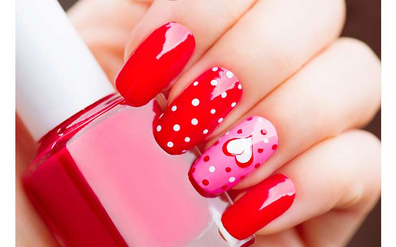 bright red nails with a valentine's day theme