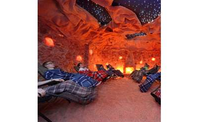 people relaxing in seats in a salt cave