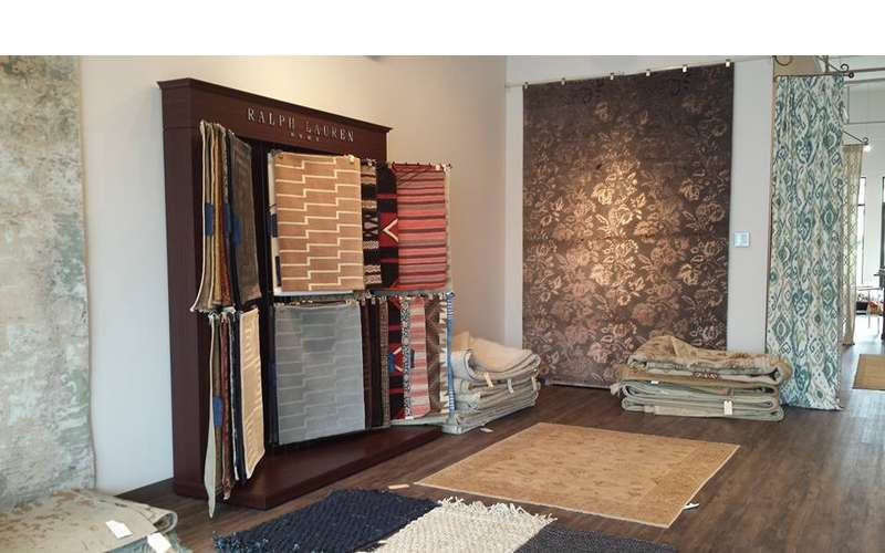 a cabinet display with different types of rugs