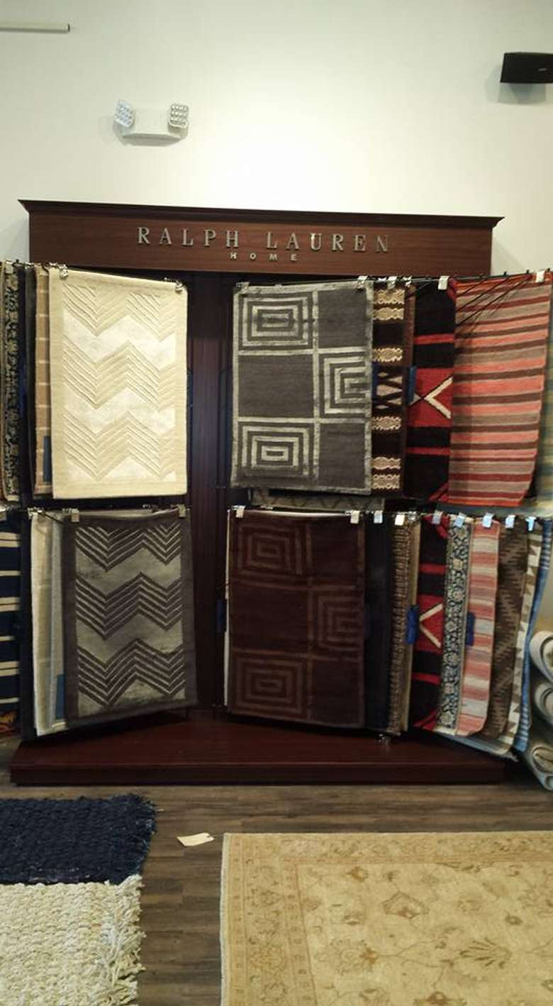 a close up look of rugs on display in a cabinet