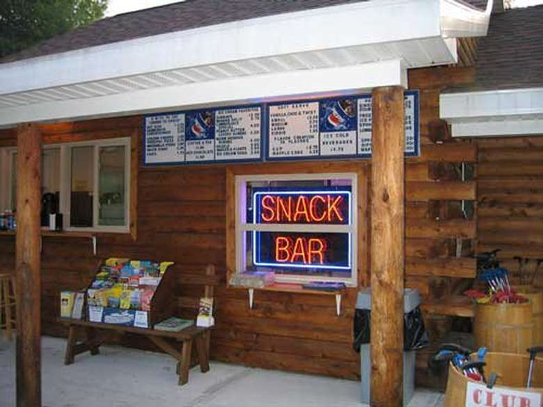 the snack bar with a light up sign saying snack bar