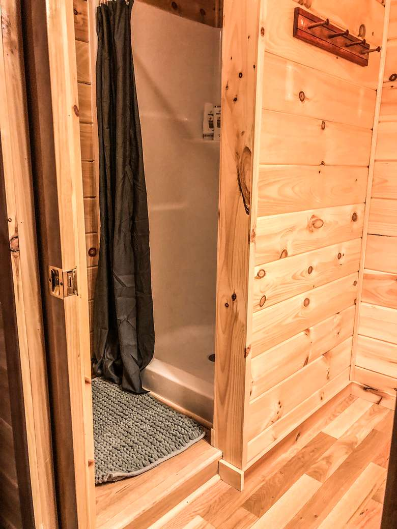 shower in the bathroom of a log home