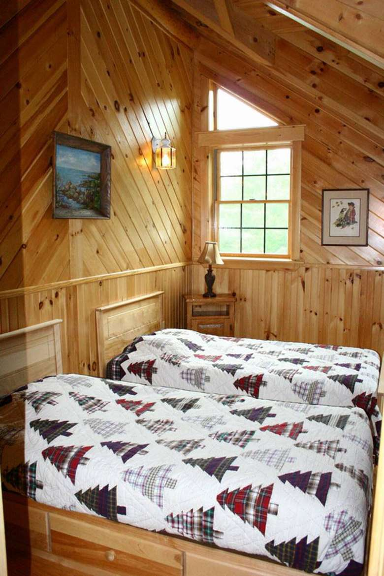 two beds in a rustic bedroom