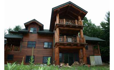 an adirondack style home with multiple levels