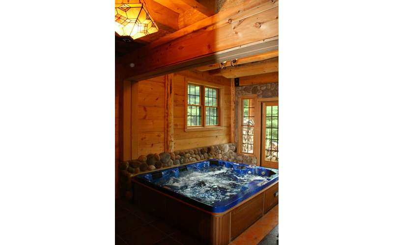 a square jacuzzi in a rustic room