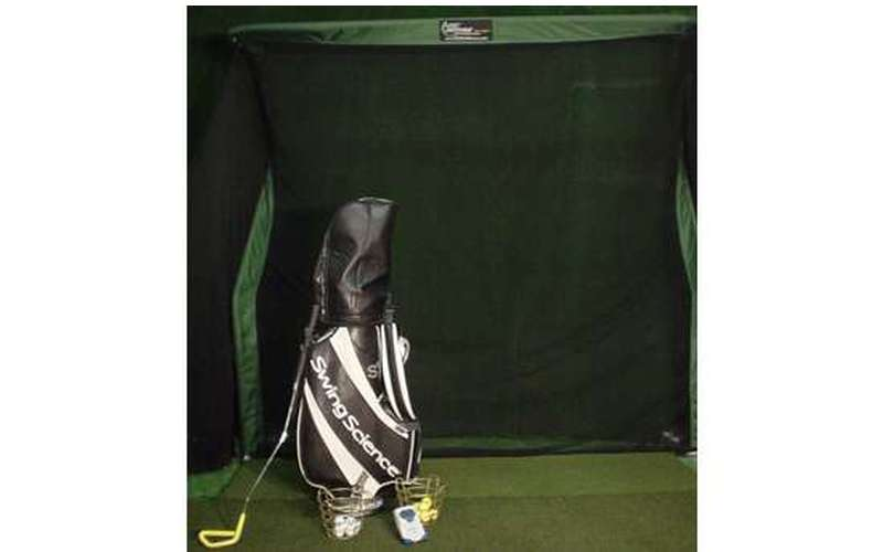 Bag of clubs with indoor golf net