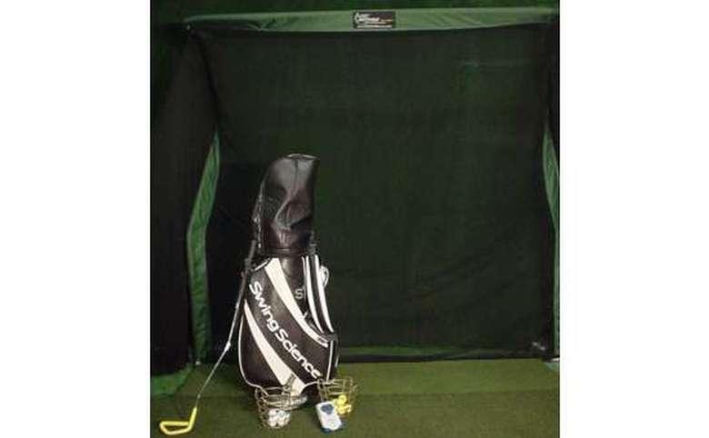 Bag of clubs with indoor golf net