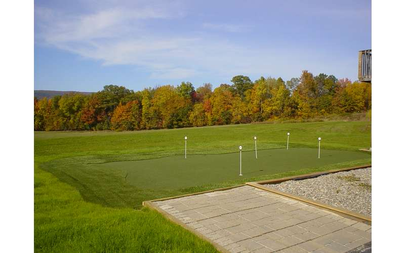 Putting green with fall foliage in the background