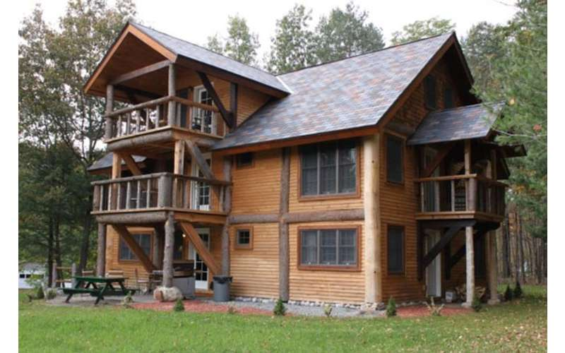 the outside of a large Adirondack-style house
