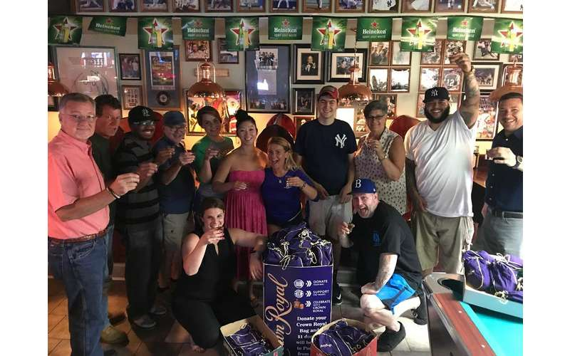 group of people at bar posing