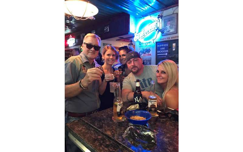 group of people at bar posing