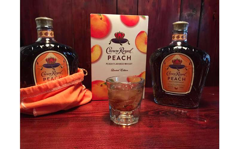 Crown Royal peach bottles and drink