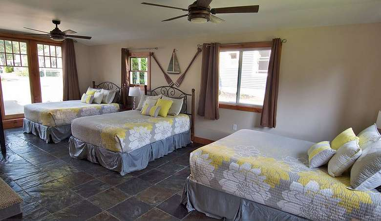 three beds in a large bedroom