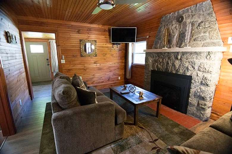 couch in front of a fireplace