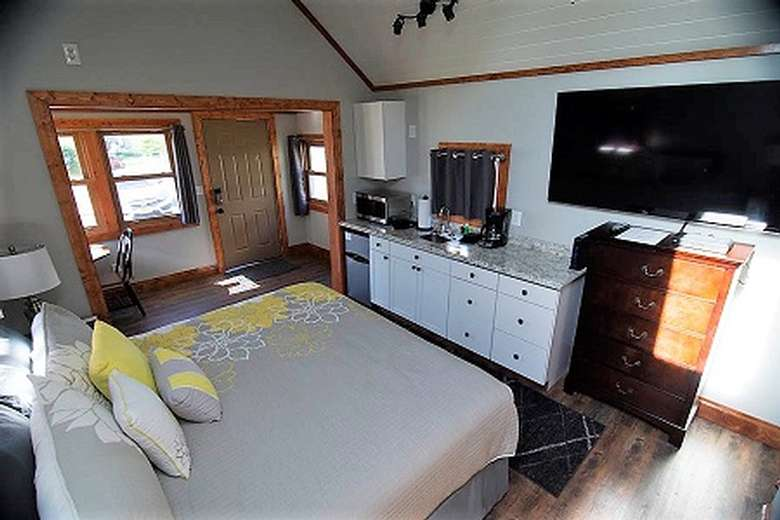 bedroom with a large bed and flat screen tv
