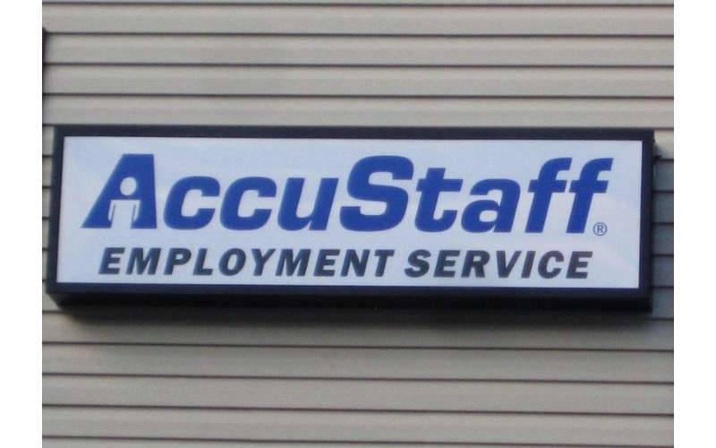 a sign for AccuStaff Employment Service