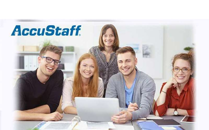 two men and three woman in front of a laptop with the AccuStaff logo in the corner