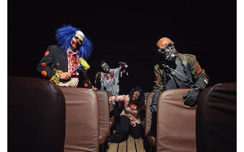 four people dressed up in scary halloween costumes