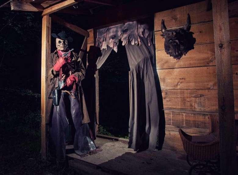 skeleton cowboy standing in a doorway