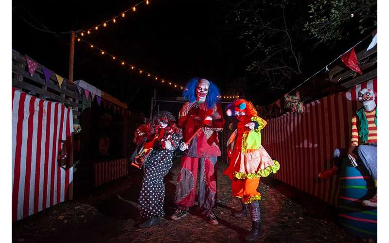 people dressed up as scary clowns