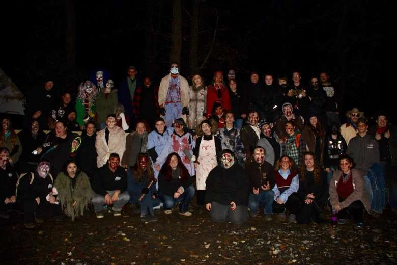 group photo of people who work at a horror attraction