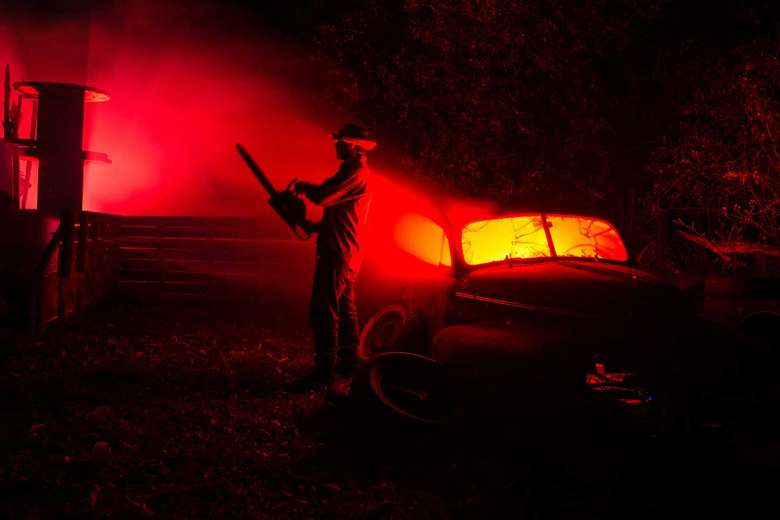 dark image with person with chainsaw