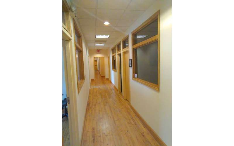 a long hallway with wooden flooring