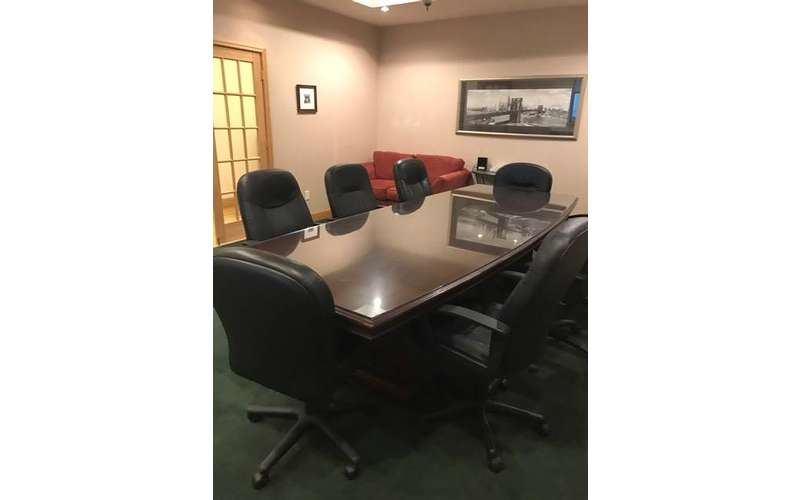 a rectangular office table in a meeting room