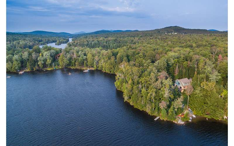 an aerial view of the lake and trees