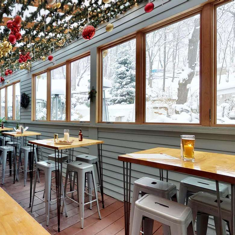 tables by windows in a restaurant with view of snow