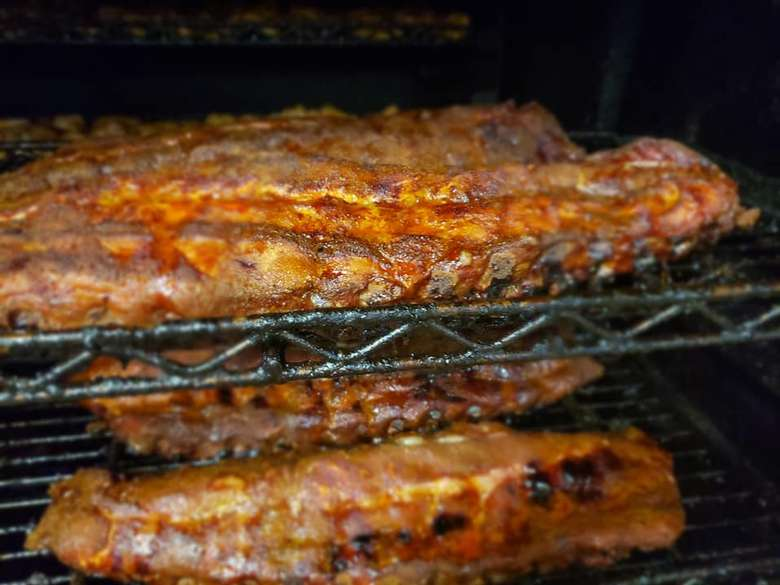 ribs cooking in a smoker