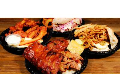 four plates of bbq food with sides