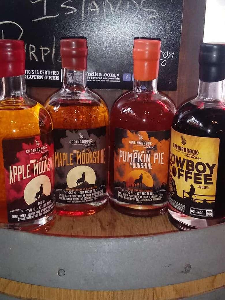 four bottles of craft beverages