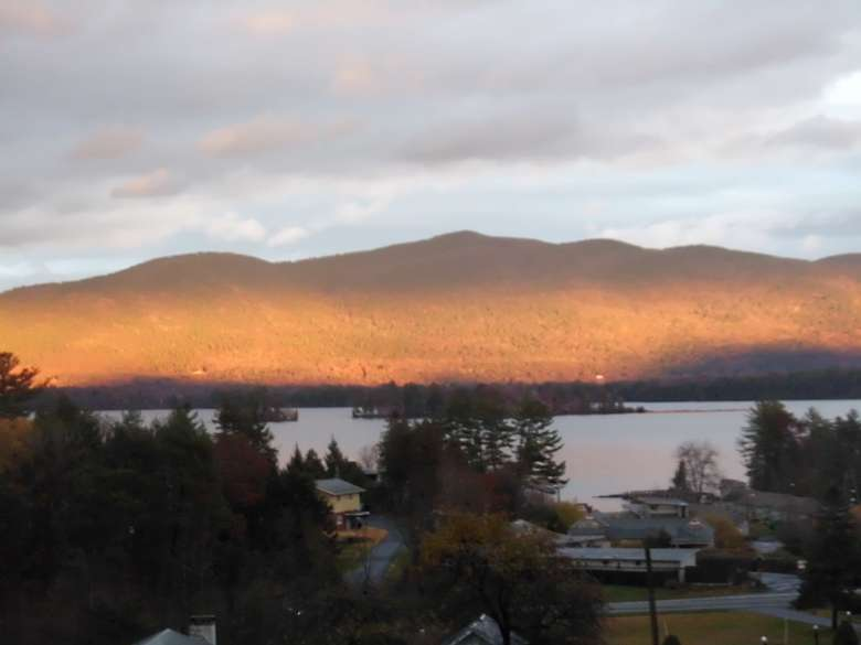 a far away view of Lake George and mountains