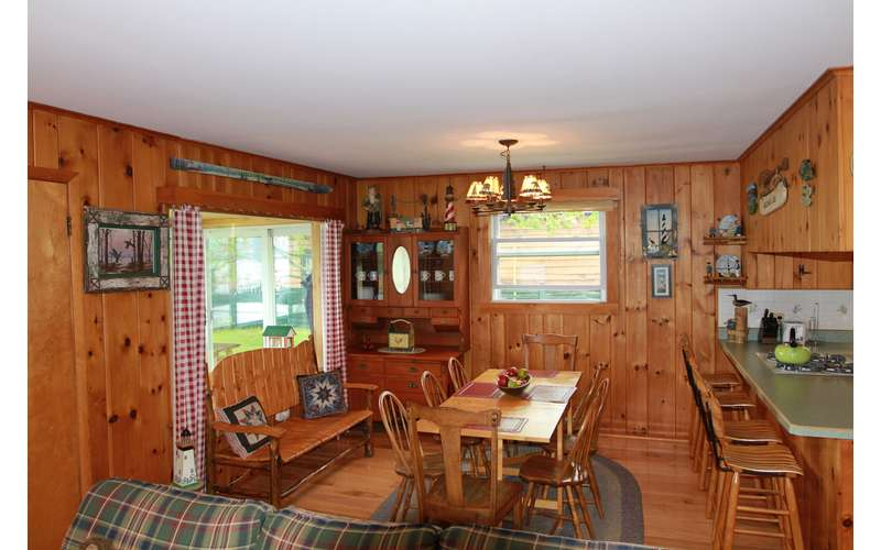 an Adirondack-themed dining room area and kitchen counter