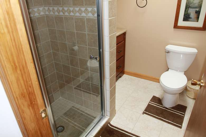 a bathroom with a glass shower and a white toilet