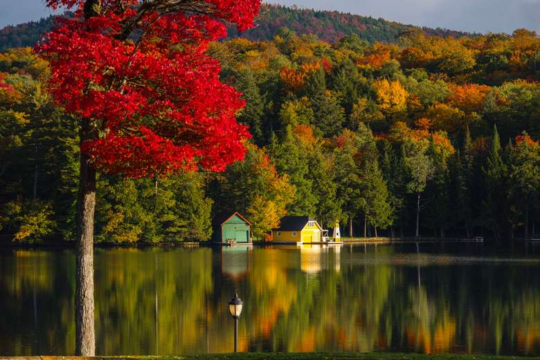 Adirondack photo of a yellow boat house in Old Forge