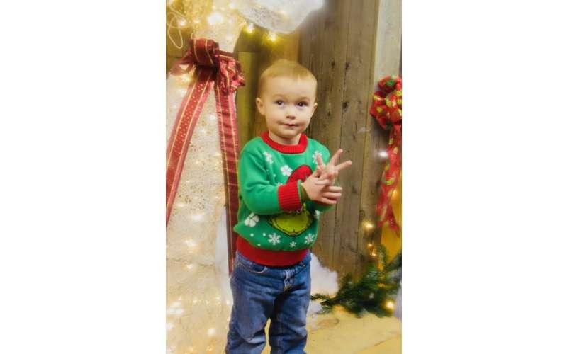 small boy in festive green shirt