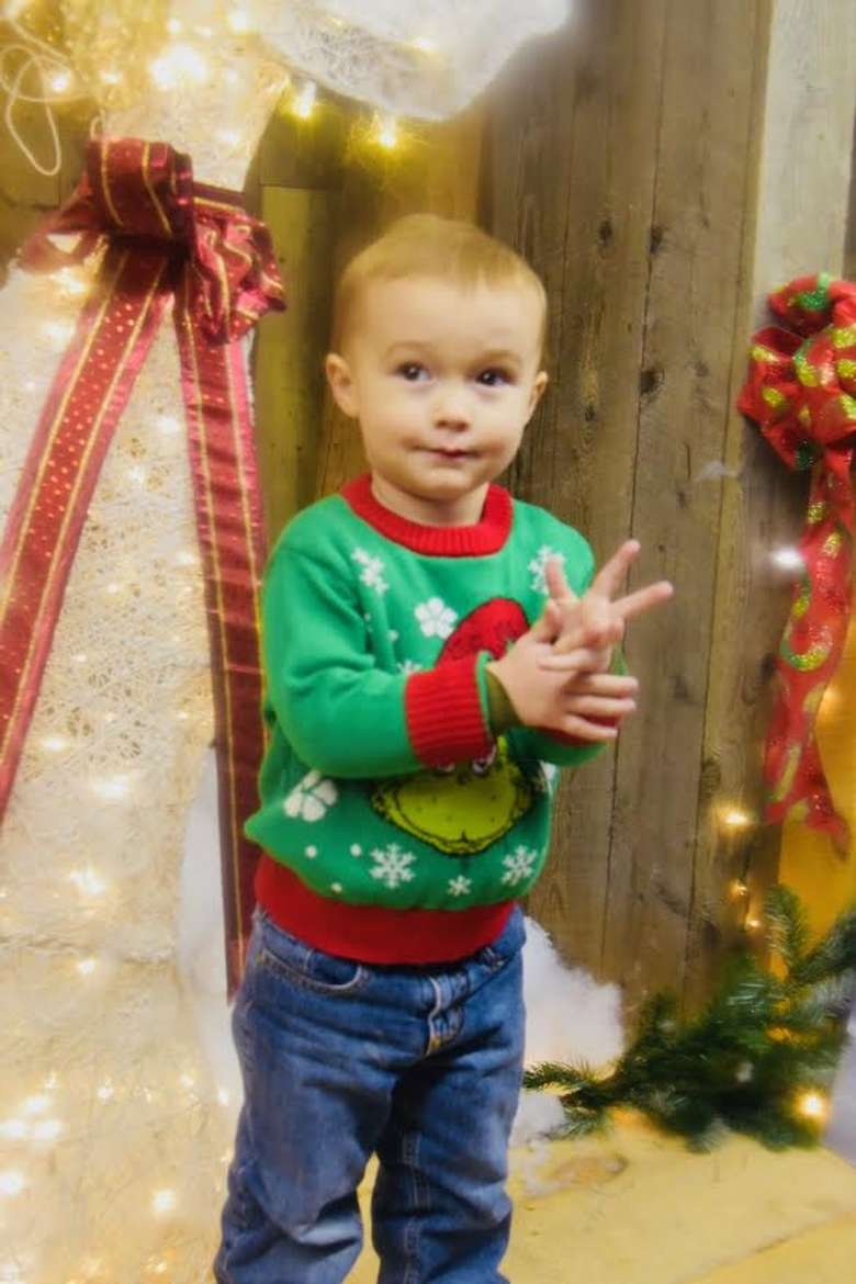 small boy in festive green shirt