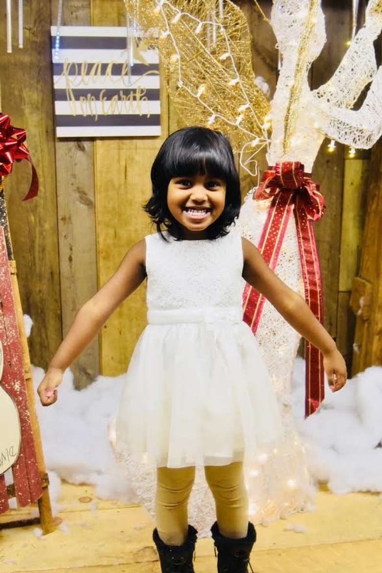 young girl in white holiday dress