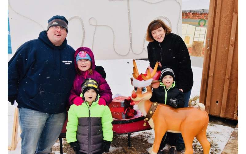 family near a rudolph statue