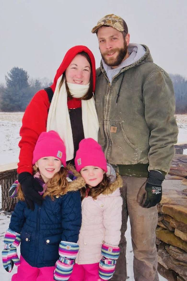 family photo of four people in winter